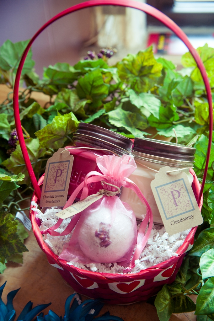 Here is your one stop shopping for that special loved one on Valentines Day. This heart woven basket is equipped with Chardonnay and Chocolate covered Strawberries candles along with a decadent Fresh Cut Roses bath fizzy. Encased in shrink wrap, this adorable basket is available while supplies last.